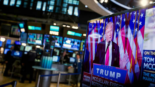 U.S. President-elect Donald Trump is seen speaking on a television on the floor of the New York Stock Exchange (NYSE) in New York, U.S., on Wednesday, Nov. 9, 2016.