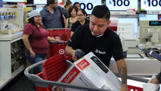 An employee scans a purchase at a Target store in Culver City, California.