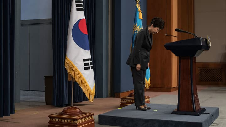 South Korean President Park Geun-Hye bows prior to delivering an address to the nation, at the presidential Blue House on November 4, 2016 in Seoul, South Korea. She has come under fire following an influence-peddling scandal.