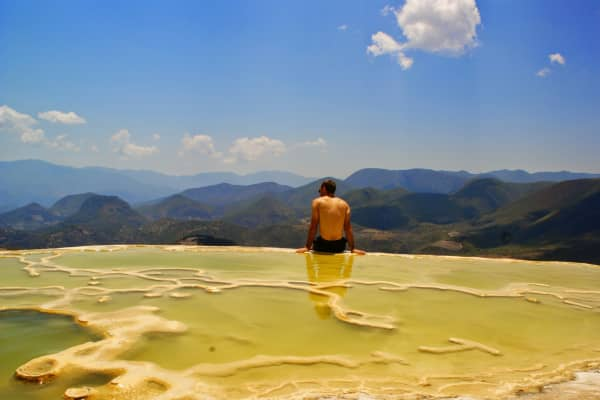 Scott Keyes in Hierve el Agua, Mexico, on a round-the-world trip he took with his fiancee last spring. They flew 20,000 miles to 13 countries for 136,500 frequent flyer miles and $20 per flight in taxes and fees.