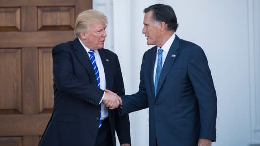 President-elect Donald Trump and Mitt Romney walk out after a meeting at the Trump National Golf Club Bedminster clubhouse at Trump National Golf Club Bedminster in Bedminster Township, N.J. on Saturday, Nov. 19, 2016.