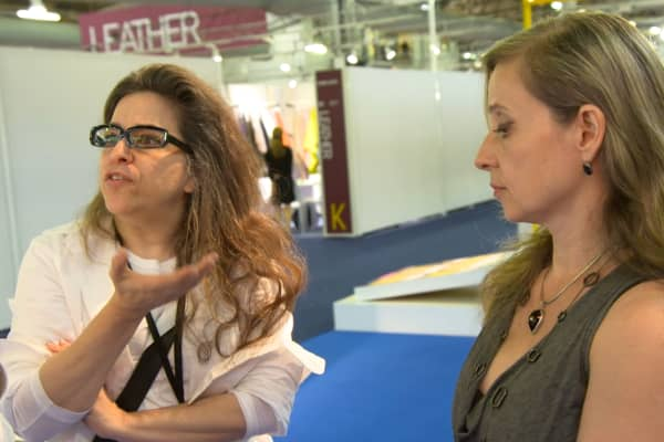 "Fashion designer Susana Monaco (L) and her vice president of operations Anna Pavel (R) at Premiere Vision New York, a global fashion expo. ""She dismisses everything that I ever tried,"" Monaco says. ""I've lost my feel to do beautiful things."""