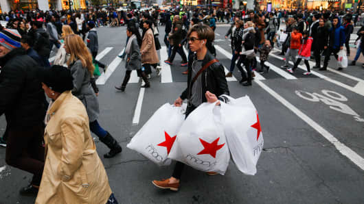 People carry retail shopping bags during Black Friday events on November 25, 2016 in New York City.