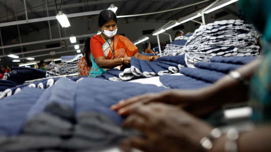 Employees sort pieces of cloth at the Estee garment factory in Tirupur, in the southern Indian state of Tamil Nadu June 19, 2013.