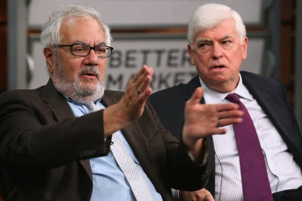 Former Rep. Barney Frank (D-Mass.) (L) and former Sen. Chris Dodd (D-Conn.) talk about their hallmark and namesake legislation, the Dodd-Frank Wall Street reform law, on the fifth anniversary of the law at the Newseum July 20, 2015, in Washington.