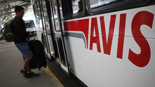 A customer boards an Avis Budget Group Inc. shuttle bus at the Denver International Airport (DEN) in Denver, Colorado, U.S., on Wednesday, Oct. 28, 2015.