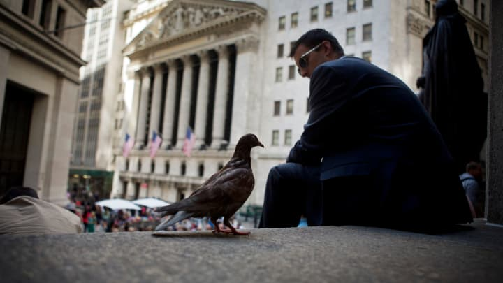 A pigeon stands on the steps of Federal Hall across from the New York Stock Exchange in New York.