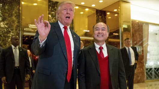 President-elect Donald Trump, accompanied by SoftBank CEO Masayoshi Son, speaks to members of the media at Trump Tower in New York, Tuesday, Dec. 6, 2016.
