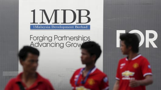 Singapore's central bank ends 1MDB review, penalises Credit Suisse, UOB