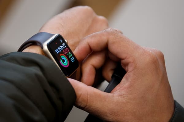 A customer tries out an Apple Watch Nike+ at an Apple Store in the SoHo neighborhood of Manhattan, October 28, 2016 in New York City.