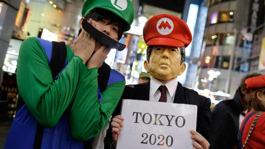 Japanese Prime Minister Shinzo Abe's Super Mario impersonation to promote Tokyo as the host city for the 2020 Olympics inspired these Halloween partygoers.