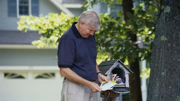 Man collecting mail from mailbox