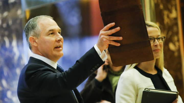 Oklahoma AG Scott Pruitt (L) arrives for meetings with President-elect Donald Trump November 28, 2016 at Trump Tower in New York.