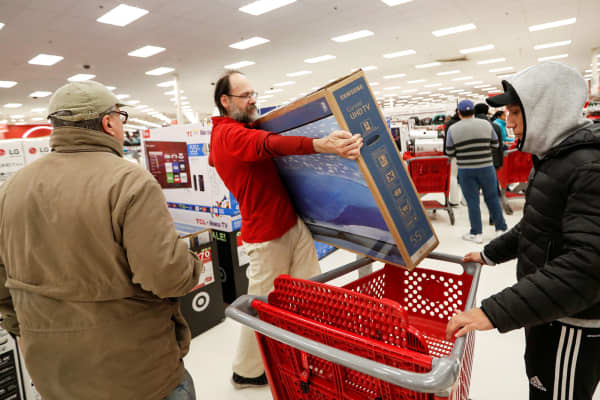 Store employee helps a customer with his TV purchase at a Target store in Chicago.