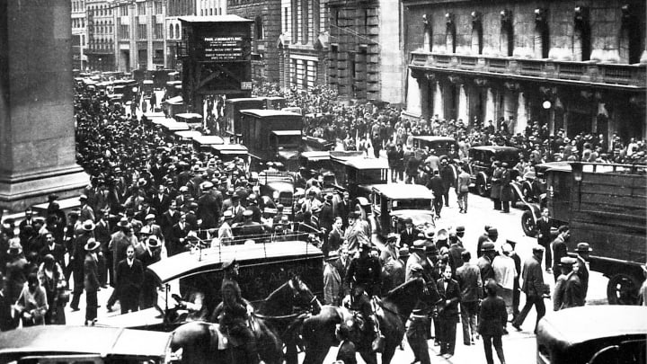 Crowds gather outside the New York Stock Exchange dring the Wall Street Crash in 1929.