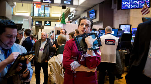 A trader works on the floor of the New York Stock Exchange (NYSE) in New York, U.S., on Friday, Dec. 2, 2016.
