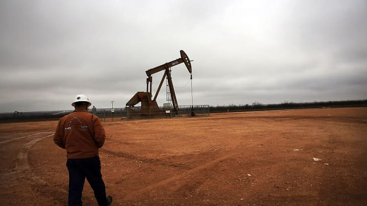 An oil well owned and operated by Apache Corporation in the Permian Basin are viewed on February 5, 2015 in Garden City, Texas.