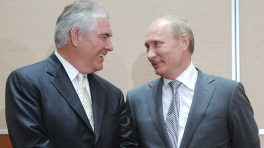 Russia's Prime Minister Vladimir Putin speaks with then-ExxonMobil Chief Executive Officer Rex Tillerson on August 30, 2011.