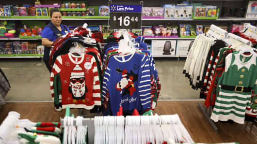 An employee arranges holiday clothing at a Wal-Mart Stores Inc. location in Burbank, California.