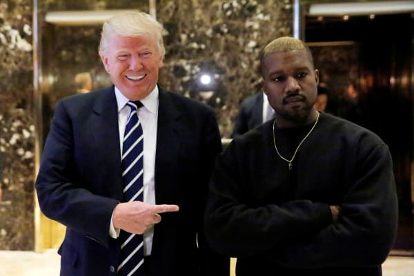 President-elect Donald Trump and musician Kanye West pose for media at Trump Tower in Manhattan, New York City, U.S., December 13, 2016.