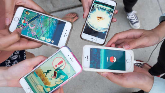 Pokemon Go players are seen in search of Pokemon and other in game items in Pasadena Playhouse District
