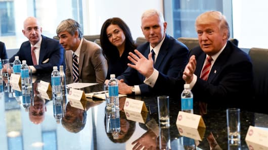 (L-R) Amazon's chief Jeff Bezos, Larry Page of Alphabet, Facebook COO Sheryl Sandberg , Vice President-elect Mike Pence and President-elect Donald Trump attend a meeting at Trump Tower December 14, 2016 in New York.