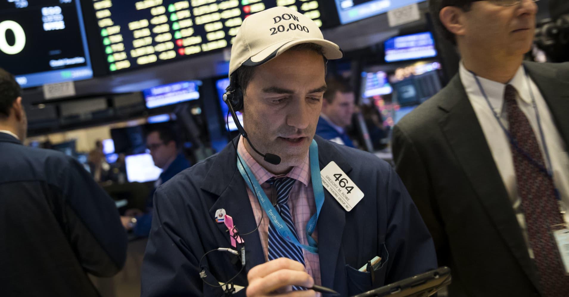 US stocks climb higher as Wall Street awaits health-care vote; financials rise 1%