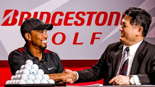 Tiger Woods celebrates new deal with Bridgestone Golf CEO Angel Ilagan