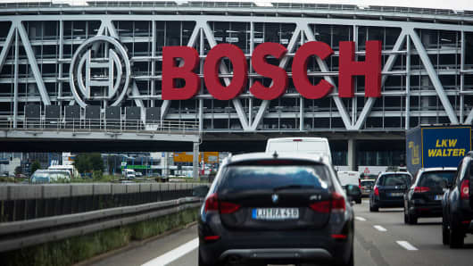 The Robert Bosch GmbH logo sits on the exterior of Messe Stuttgart exhibition center as automobiles pass in Stuttgart, Germany, on Monday, July 18, 2016.