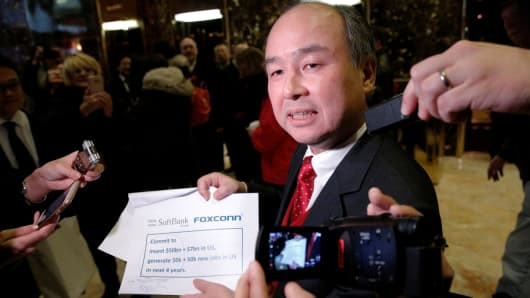 Softbank CEO Masayoshi Son speaks to the press after meeting with U.S. President-elect Donald Trump at Trump Tower in Manhattan, New York City, U.S., December 6, 2016.