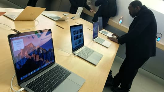 A customer looks at MacBook Pro computers at the Apple Store in New York City.