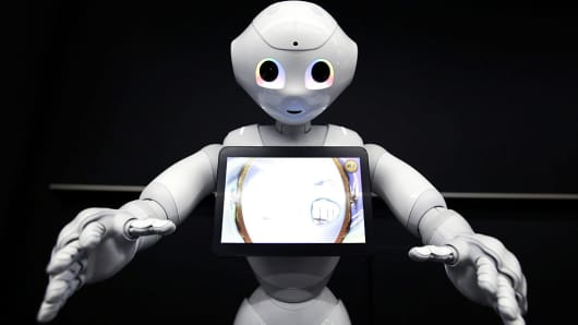SoftBank Group Corp.'s Pepper the humanoid robot performs during a demonstration at a media briefing in Tokyo, Japan, on Thursday, May 19, 2016.
