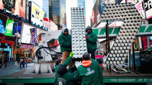 Workers unload the numerals '17' as they arrive in Times Square ahead of the New Year's Eve celebration in Times Square, December 15, 2016 in New York City.