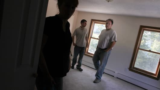 Prospective buyers look at a home in Ansonia, Conn.