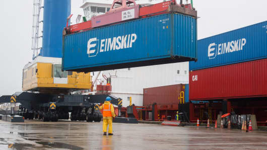 Containers are unloaded from the Eimskip ship Bruarfoss in Portland, Maine.