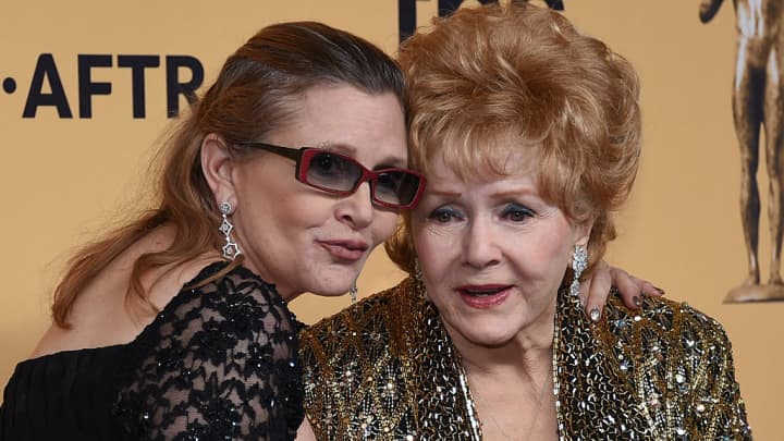 Actresses Debbie Reynolds (R) and Carrie Fisher pose in the press room during the 21st Annual Screen Actors Guild Awards.