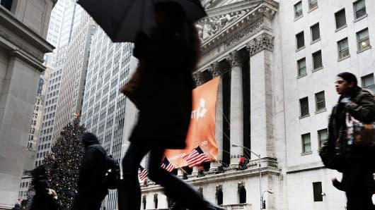 People walking outside the New York Stock Exchange on January 3, 2017.