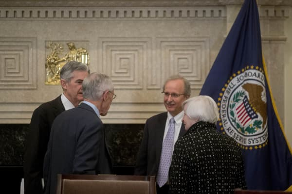 Janet Yellen, chair of the U.S. Federal Reserve, from right. Scott Alvarez, general council with the U.S. Federal Reserve, Stanley Fischer, vice chairman of the U.S. Federal Reserve, and Jerome Powell, governor of the U.S. Federal Reserve, talk after a meeting of the Board of Governors of the Federal Reserve in Washington, D.C., U.S., on Monday, Nov. 30, 2015.