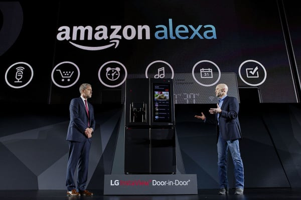 David VanderWaal, vice president of marketing for LG Electronics USA, left, and Michael George, vice president of Alexa, Echo, and Appstore at Amazon.com Inc., speak about the Amazon Alexa partnership with the LG InstaView Door-In-Door smart refrigerator during the company's press conference at the 2017 Consumer Electronics Show (CES) in Las Vegas, Nevada, U.S., on Wednesday, Jan. 4, 2017.