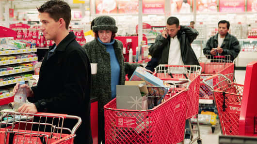 Shoppers line up to pay for their merchandise at a checkout counter in a Target store.