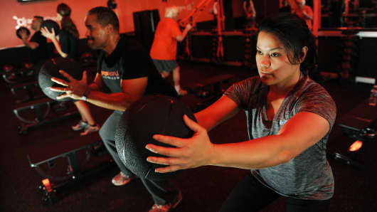 Gym goers take part in an Orange 60 class at Orangetheory Fitness in Fairfax, VA.