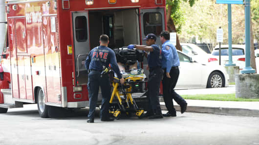 A shooting victim is unloaded from an emergency vehicle and taken into Broward Health Trauma Center in Fort Lauderdale, Fla., Friday, Jan. 6, 2017. Authorities said multiple people have died after a lone suspect opened fire at the Ft. Lauderdale, Florida, international airport.