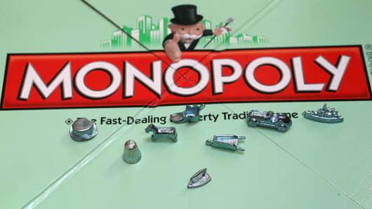 Monopoly tokens on display.