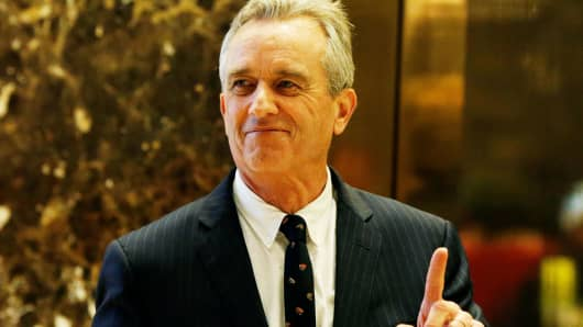 Robert F. Kennedy Jr. gestures while entering the lobby of Trump Tower in New York, Jan. 10, 2017.