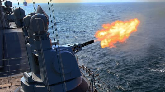 Chinese frigate 'Guangzhou' fires secondary guns during a China-Russia naval joint drill at sea off south China's Guangdong Province, Sept. 18, 2016.