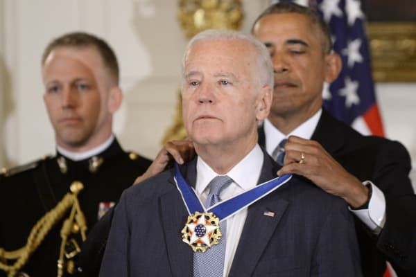President Barack Obama (R) presents the Medal of Freedom to Vice-President Joe Biden during an event in the State Dining room of the White House, January 12, 2017 in Washington.