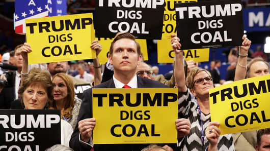 Delegates hold signs that read 'Trump Digs Coal' on the second day of the Republican National Convention on July 19, 2016 at the Quicken Loans Arena in Cleveland, Ohio.