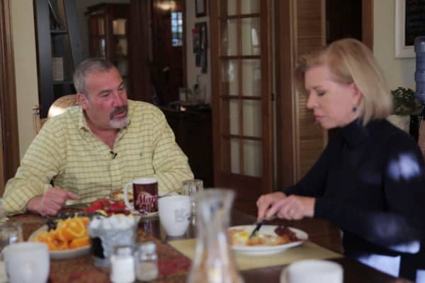 Jane Wells enjoys breakfast with Bud & Breakfast owner Joel Schneider.