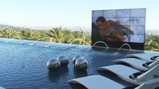 The pool area features an 18-foot wide, 12-foot tall, 4k TV screen that can be raised and lowered.