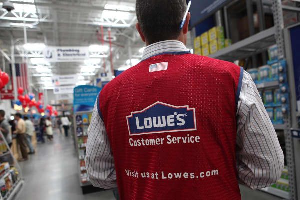 A Lowe's employee walks through the store during the grand opening of the Lowe's store in San Francisco, California.